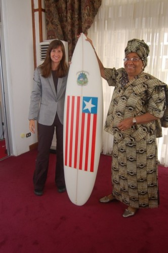 Pam and Madame President Johnson with the Liberia Pendo surfboard