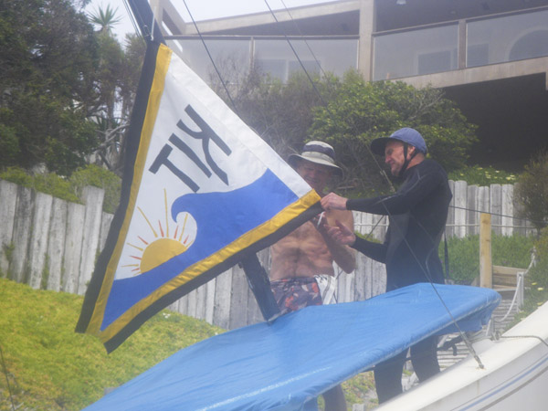 Kirk and Brit raising the flag